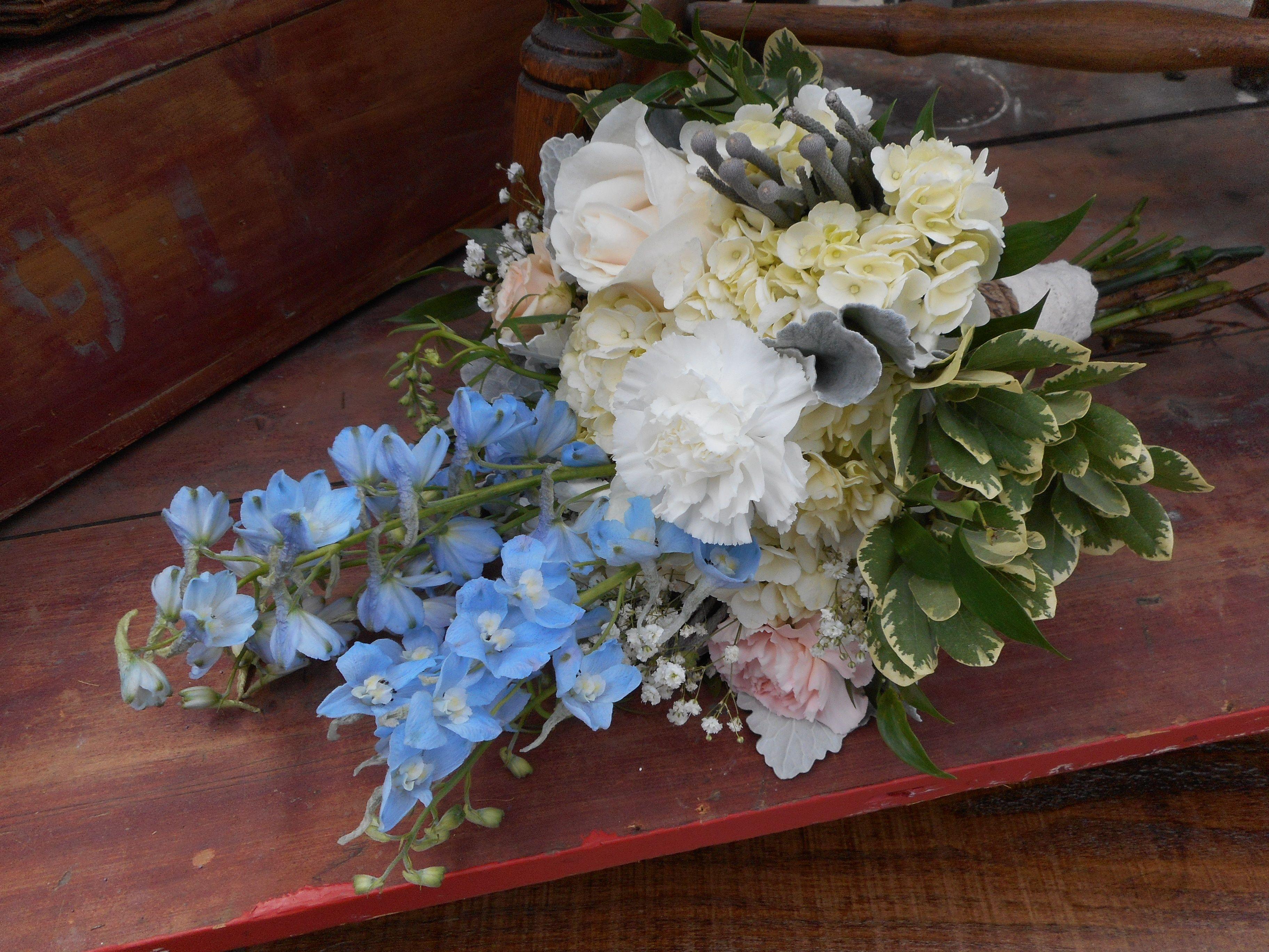 Blue and white Bridal Bouquet. #weddingflowers #orangevilleflorist #blueandwhite #delphinium #hydrangea