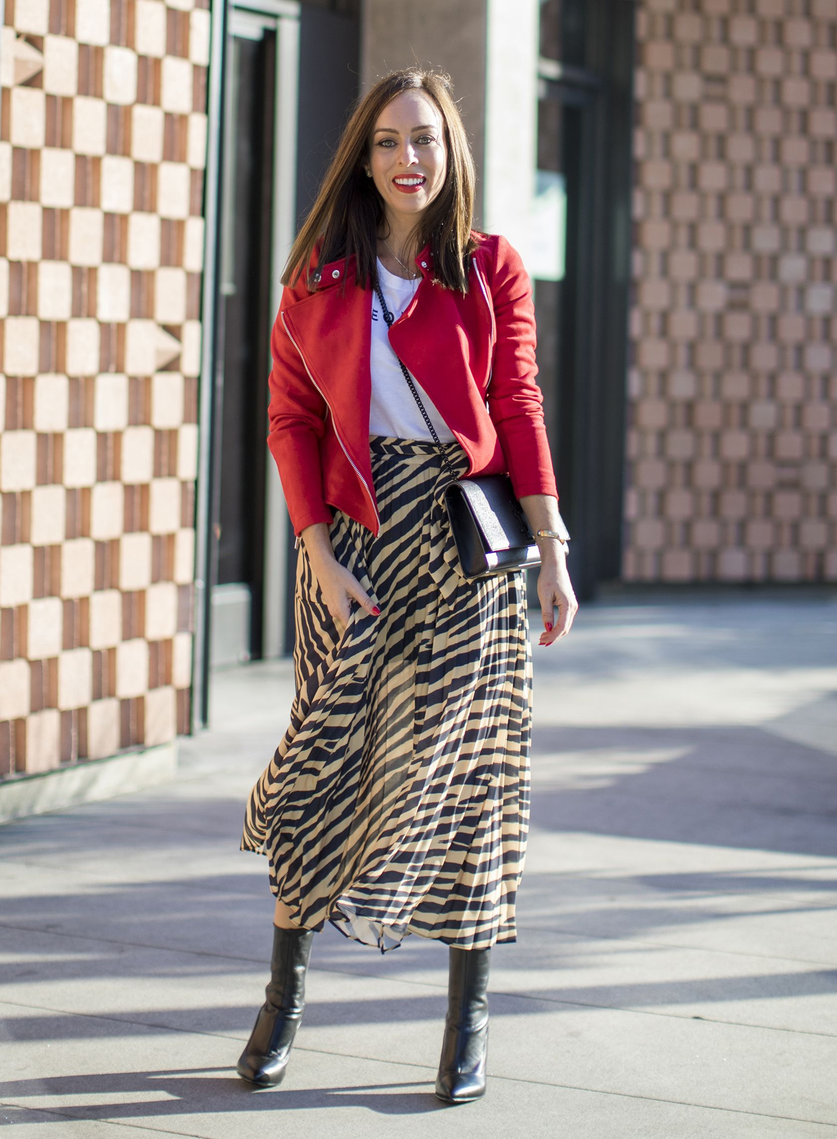 91038127a5 Sydne Style shows how to wear the animal print tend for fall 2018 in topshop  zebra skirt  zebra  skirts  animalprints  red