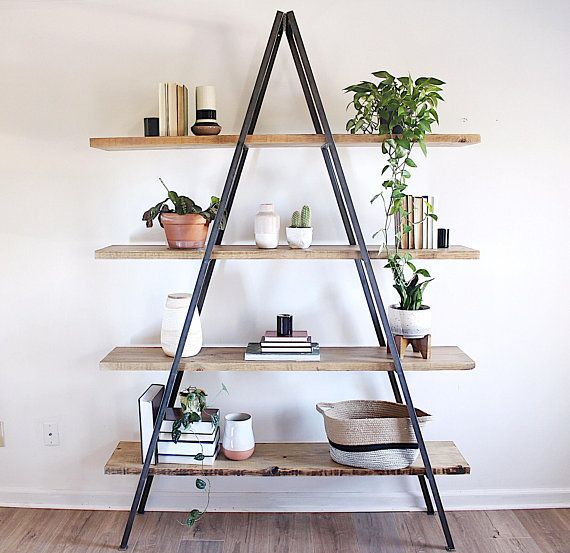 Our Andean Bookshelf Is A Minimal Approach To Displaying And Storing All Your Favorite Items From Book Frame Shelf Shelf Styling Living Room A Frame Bookshelf