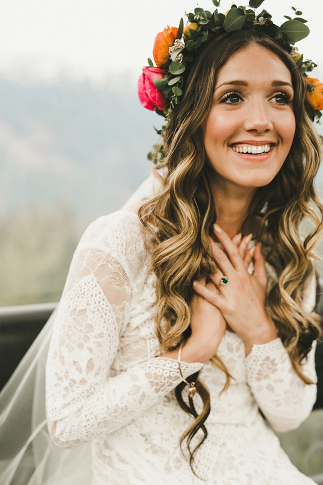 look at those lovely curls and flower crown! perfect style for the