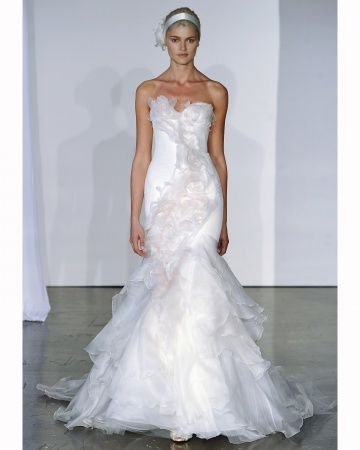 Loving the soft petals on this wedding dress by Marchesa