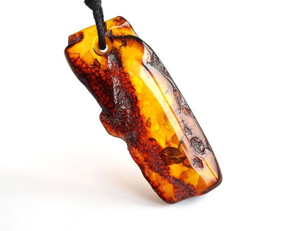 Raw unique Baltic amber pendant
