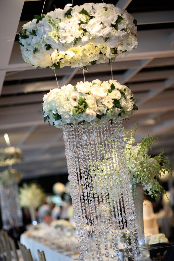 Floral chandeliers hanging from the ceiling make for a