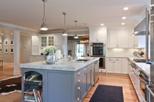 Long kitchen island with marble countertop lit up using Benson