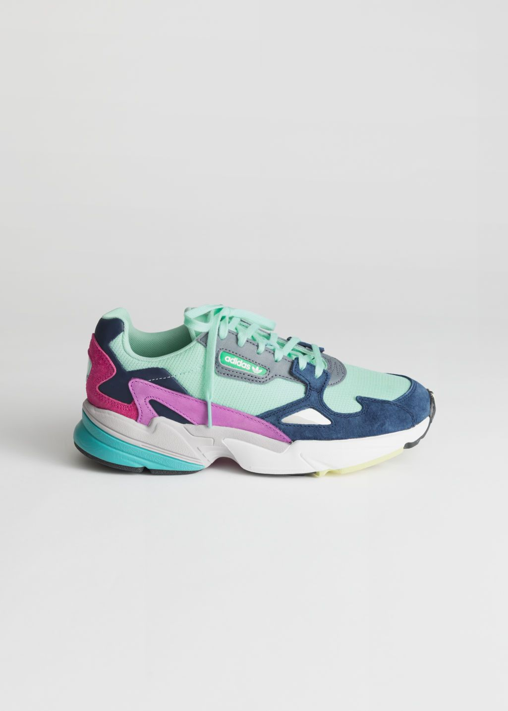 8a567bf14bd48 Front image of Stories adidas falcon in green