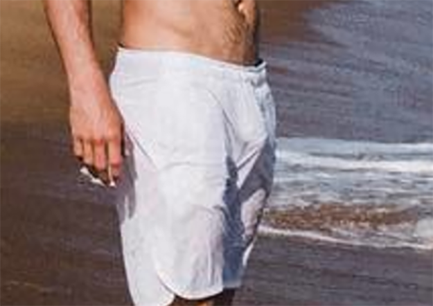 Penis shows through swim trunks