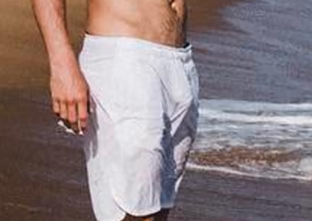 Penis shows through swim trunks