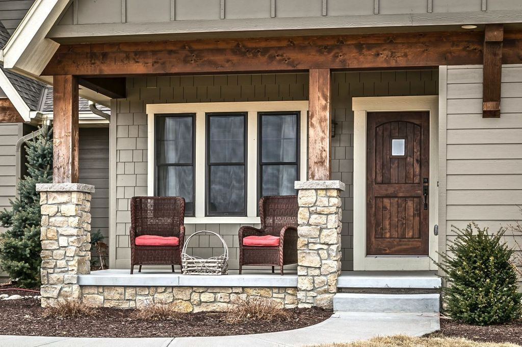 Rustic porch with pathway exterior stone floors wrap for Wrap around porch columns