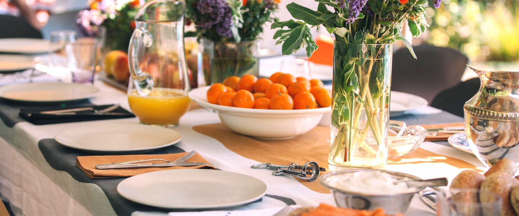 Fall brunch.  Orange, grey and purple.  Cromford tablecloth by Huddleson Linens