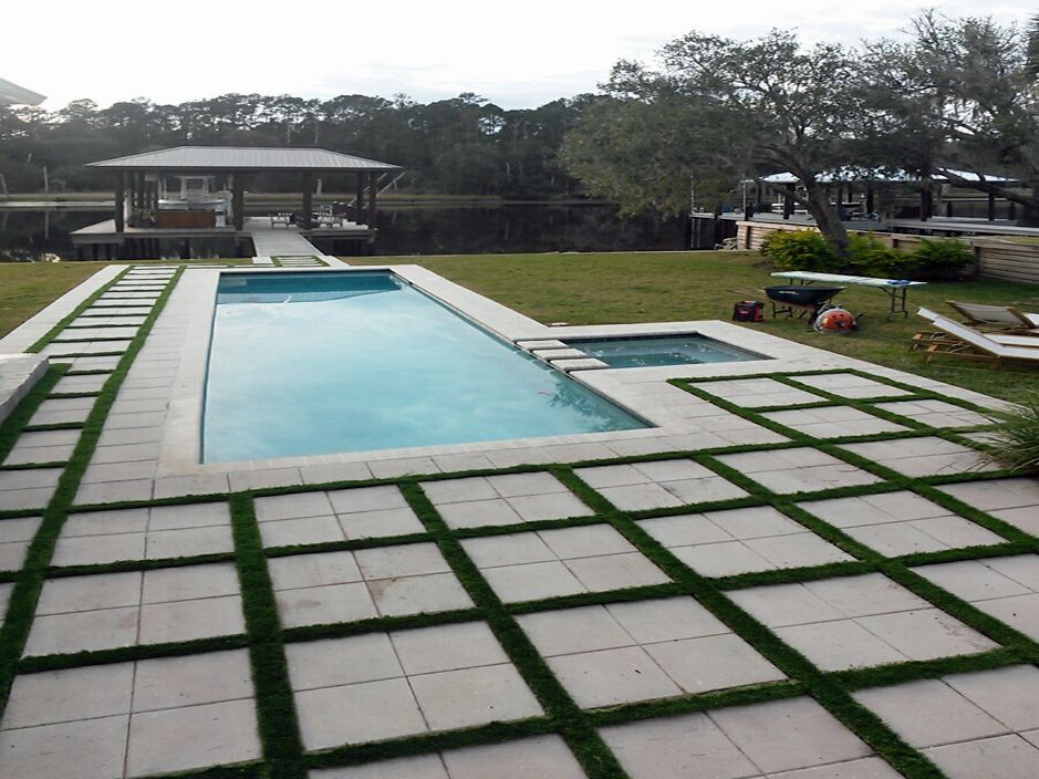 Rectangular Swimming Pool Installed With Concrete Square Pavers