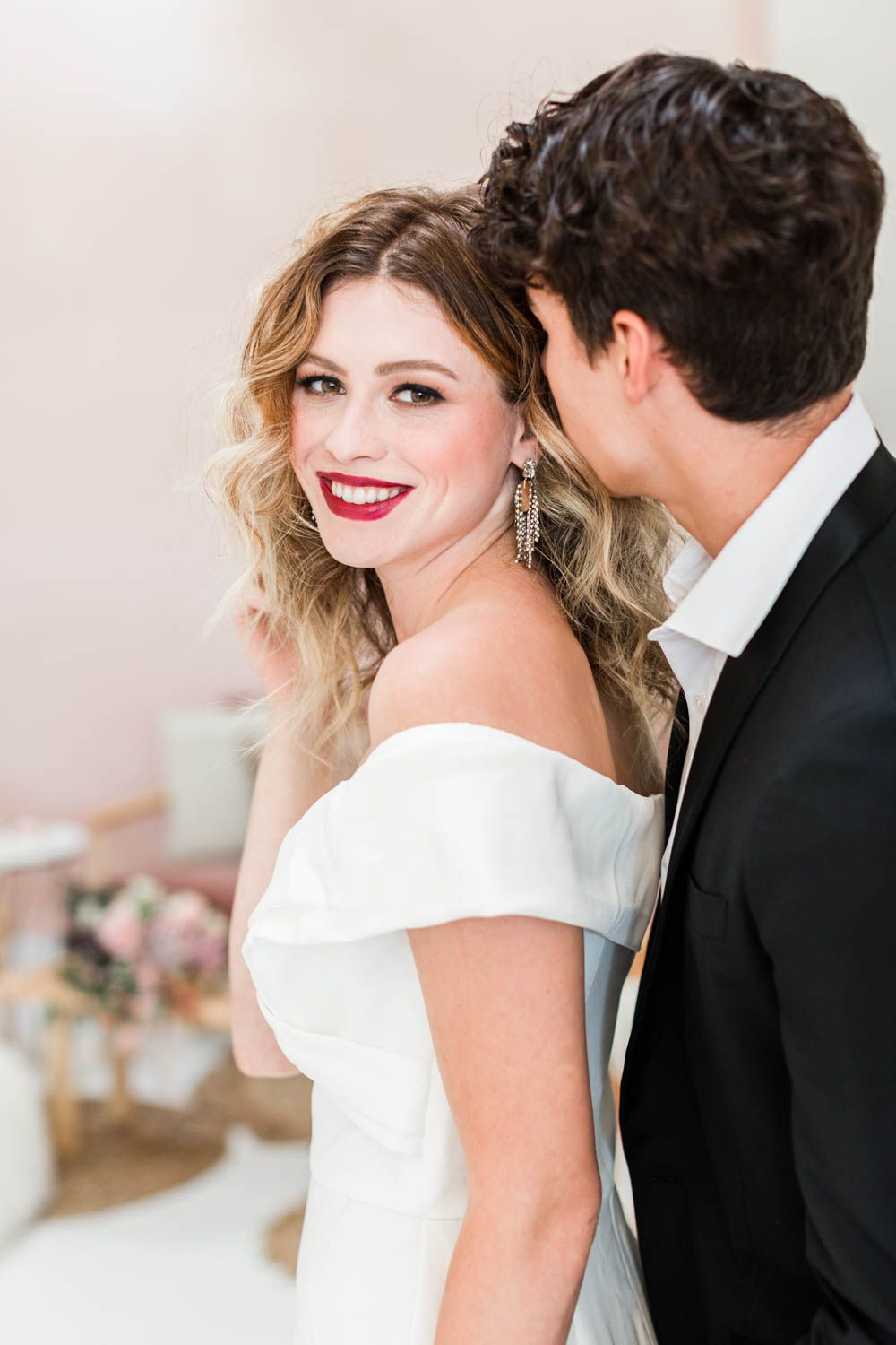87215bb3 Bride and groom at after party for wedding, bridal white jumpsuit with hair  down and curled paired with a bold deep red lipstick, Cavin Elizabeth ...