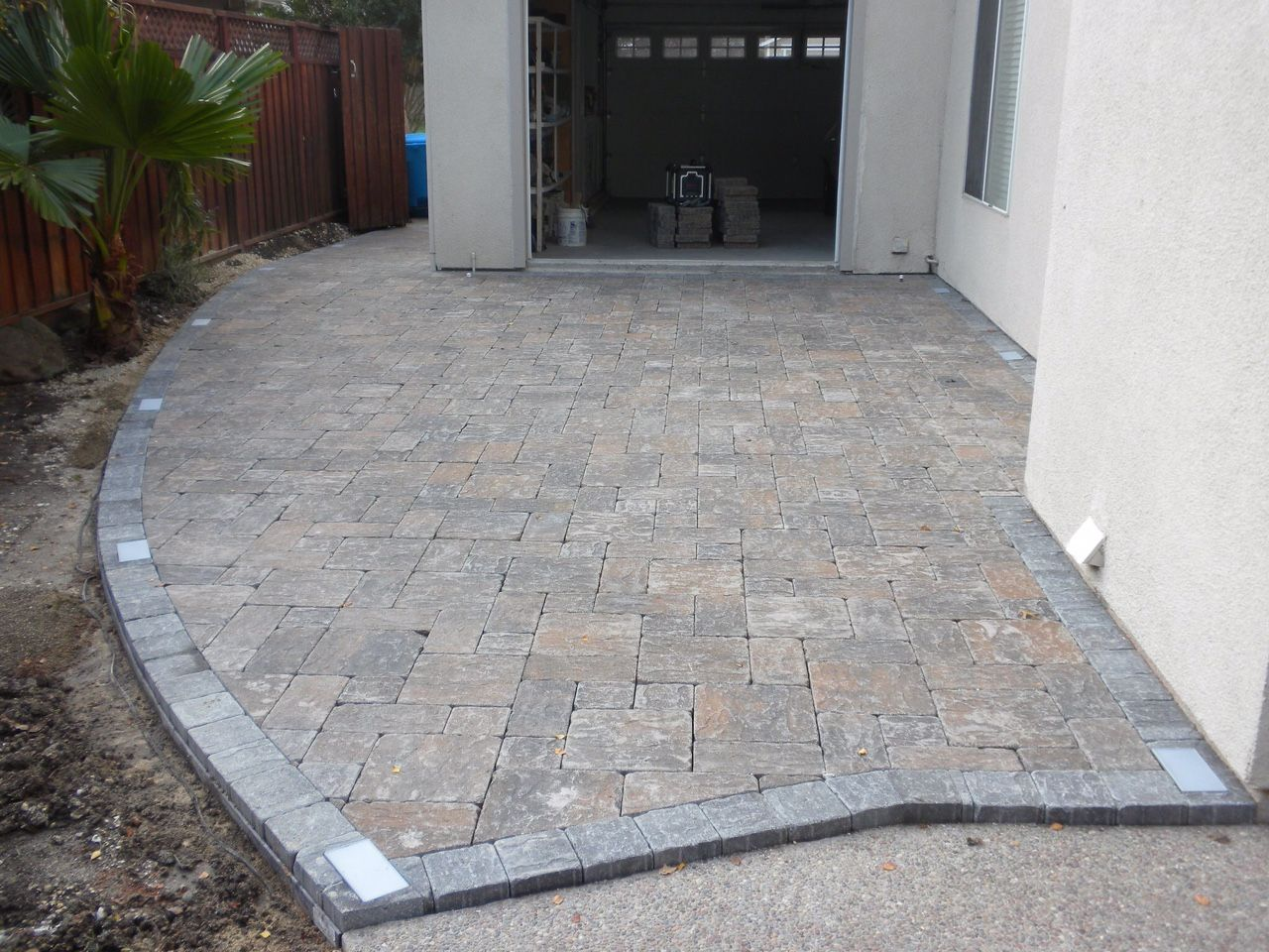 Great Backyard Patio Area With Paver Lights Installed By Solis Landscape  And Construction Using Pacific Interlocks Pavers In