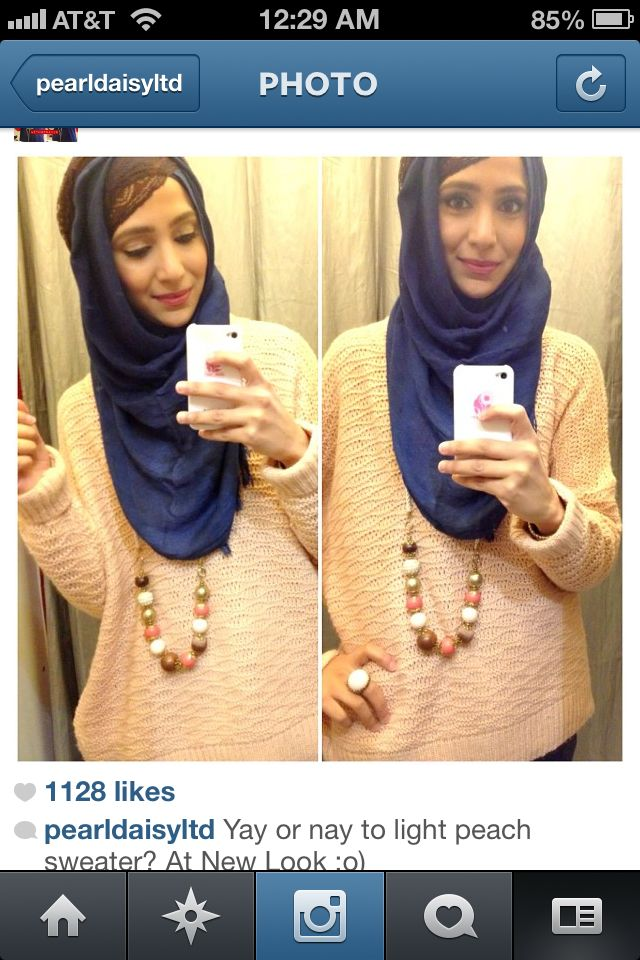 Hijab adds to the beauty. Perfect clothes for a rainy day.