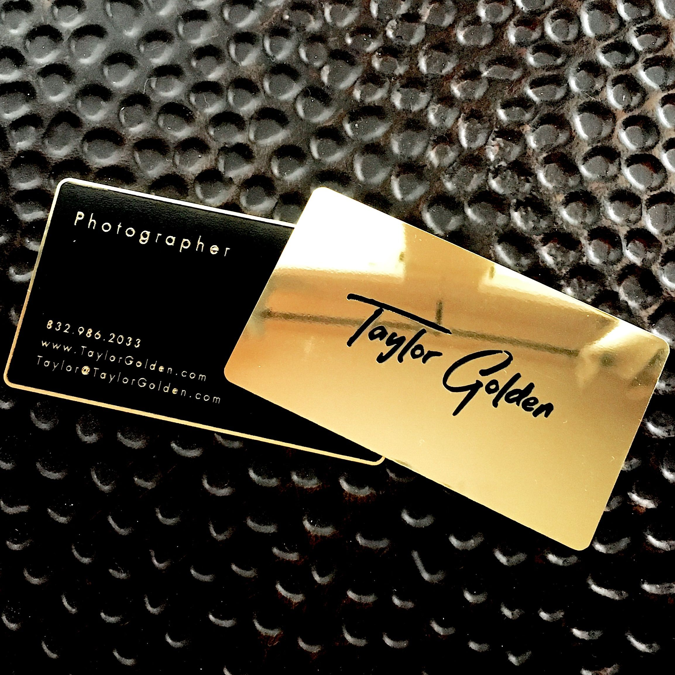Gold and black metal business cards with a polished gold