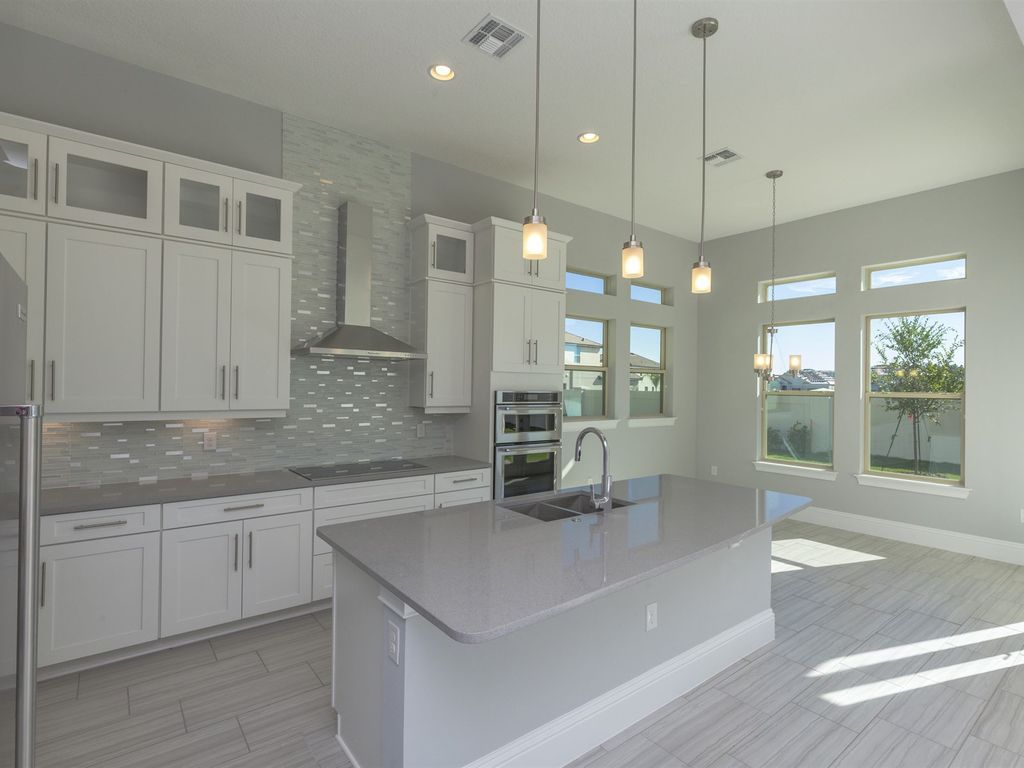 Love These Finishes Especially The Counters Transitional Kitchen With Seafoam Solid Gray And White Kitchen Kitchen Cabinets Grey And White Grey Countertops