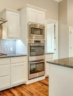 Double Oven With Microwave On Top. Lighted Cabinets. Kitchen