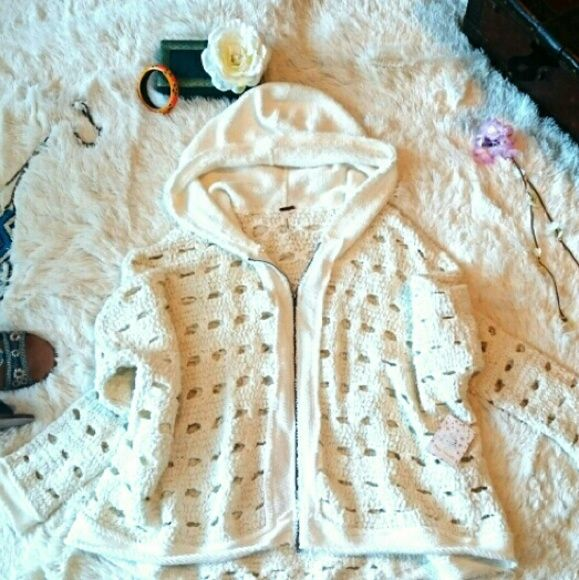 NEW! FREE PEOPLE FLURRY OPEN KNIT CARDIGAN Be cool and cozy with this cute Flurry cardigan in ivory from Free People.  Tag says M because it's meant to be of an oversized style, but I think this could fit a L and XL too! This is brand new with tags. Retails for $168..Get it here for $60!   *As always, feel free to make me a reasonable offer :)  *Bundle to save on shipping and get 15%, plus, get my spring freebie! Free People Jackets & Coats