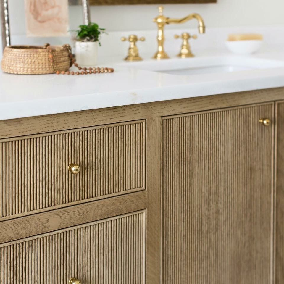 reeded cabinets, inset drawers and doors. bathroom vanity detail