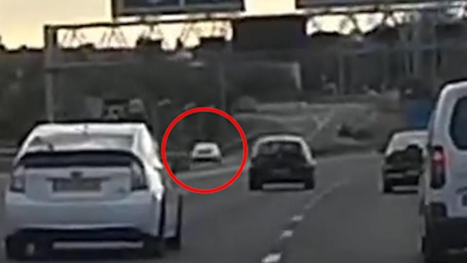 Dramatic footage shows moment car smashes straight into roundabout landing in bushes