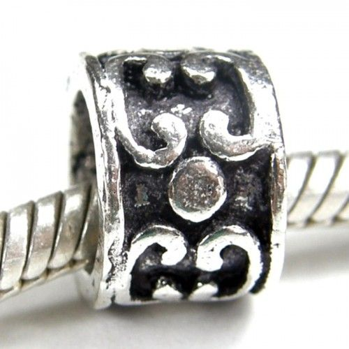 Sterling silver charm slider bead with large hole dots and a forward and backward C shaped curved pattern around the edges.  Affordable sterling silver jewelry beads that fit trendy European charm...@ artfire