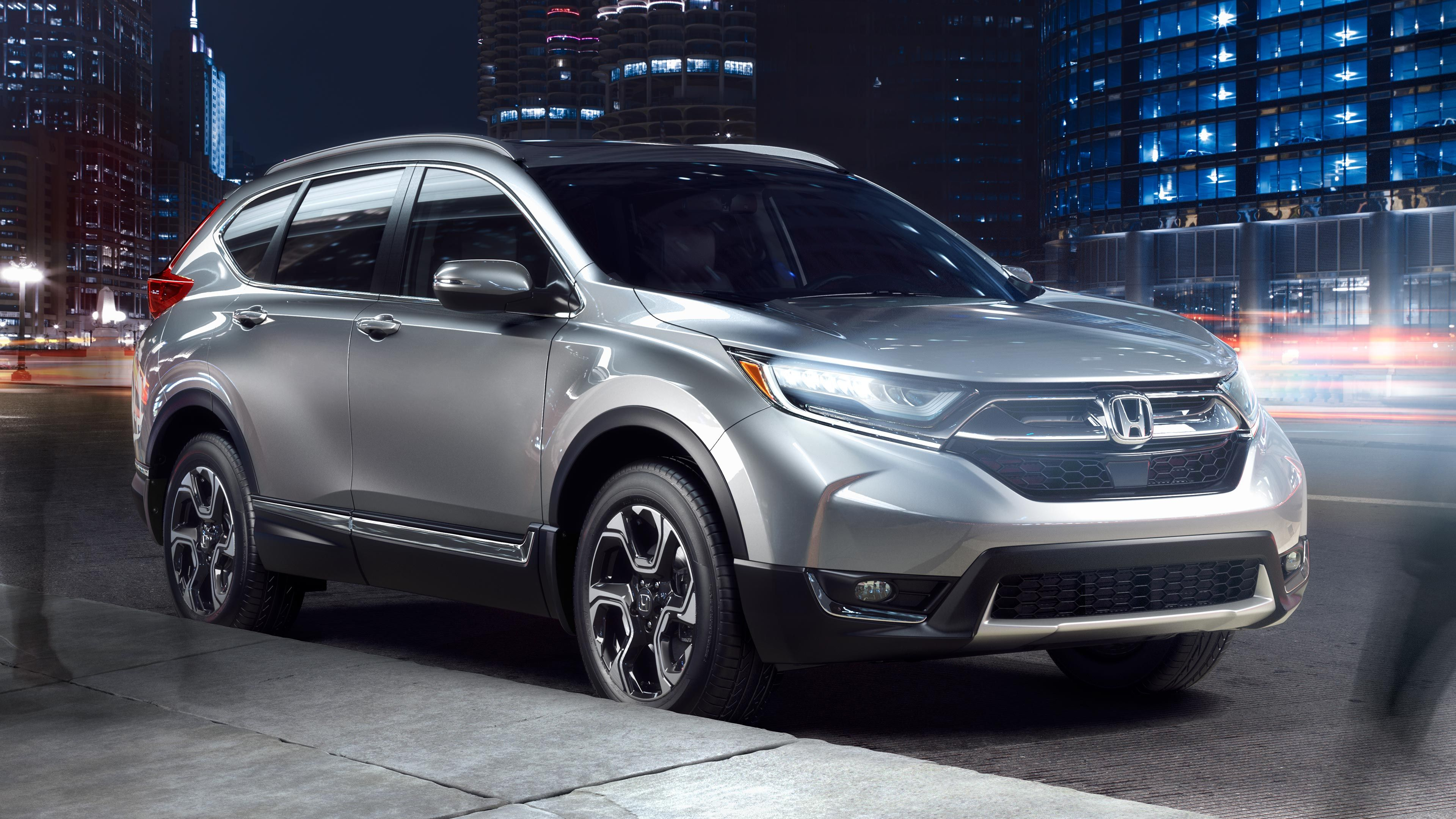 Image of 2017 CRV parked on road at night (With images