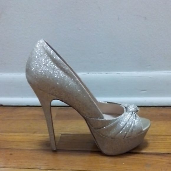 Glittery 6 inch heels Gold 6 inch sparkly heels with a hint of sliver. Worn  once. WINDSOR Shoes Heels