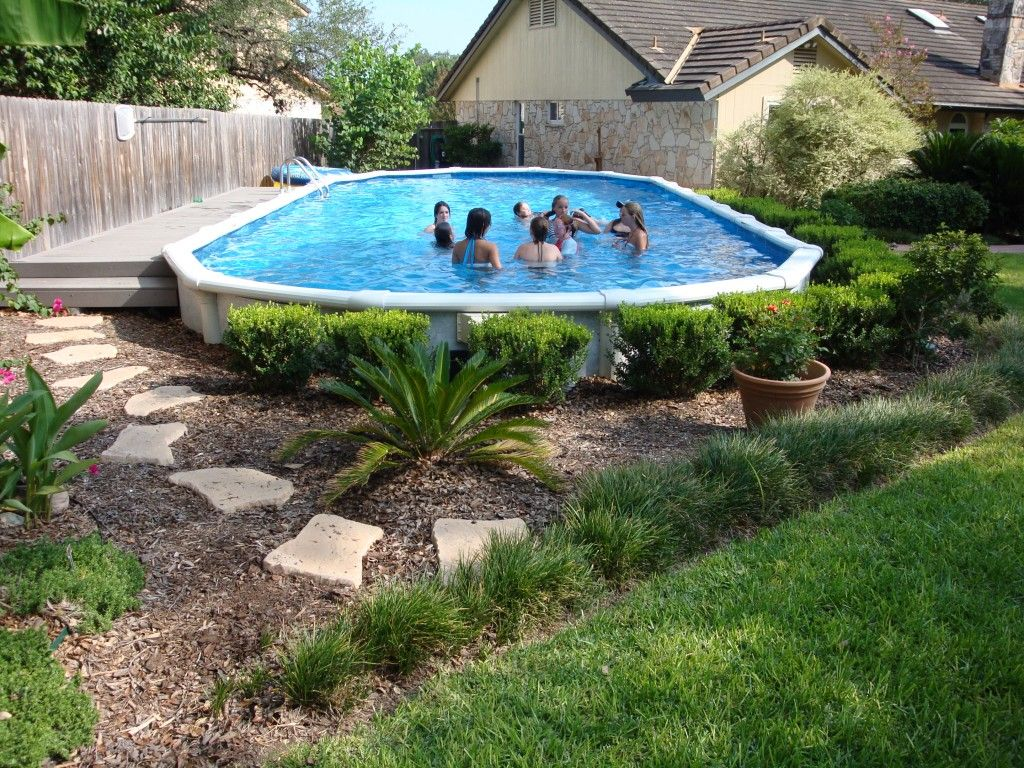 Lovely Decorative Shrubbery Around Pool. Above Ground Pool Landscaping