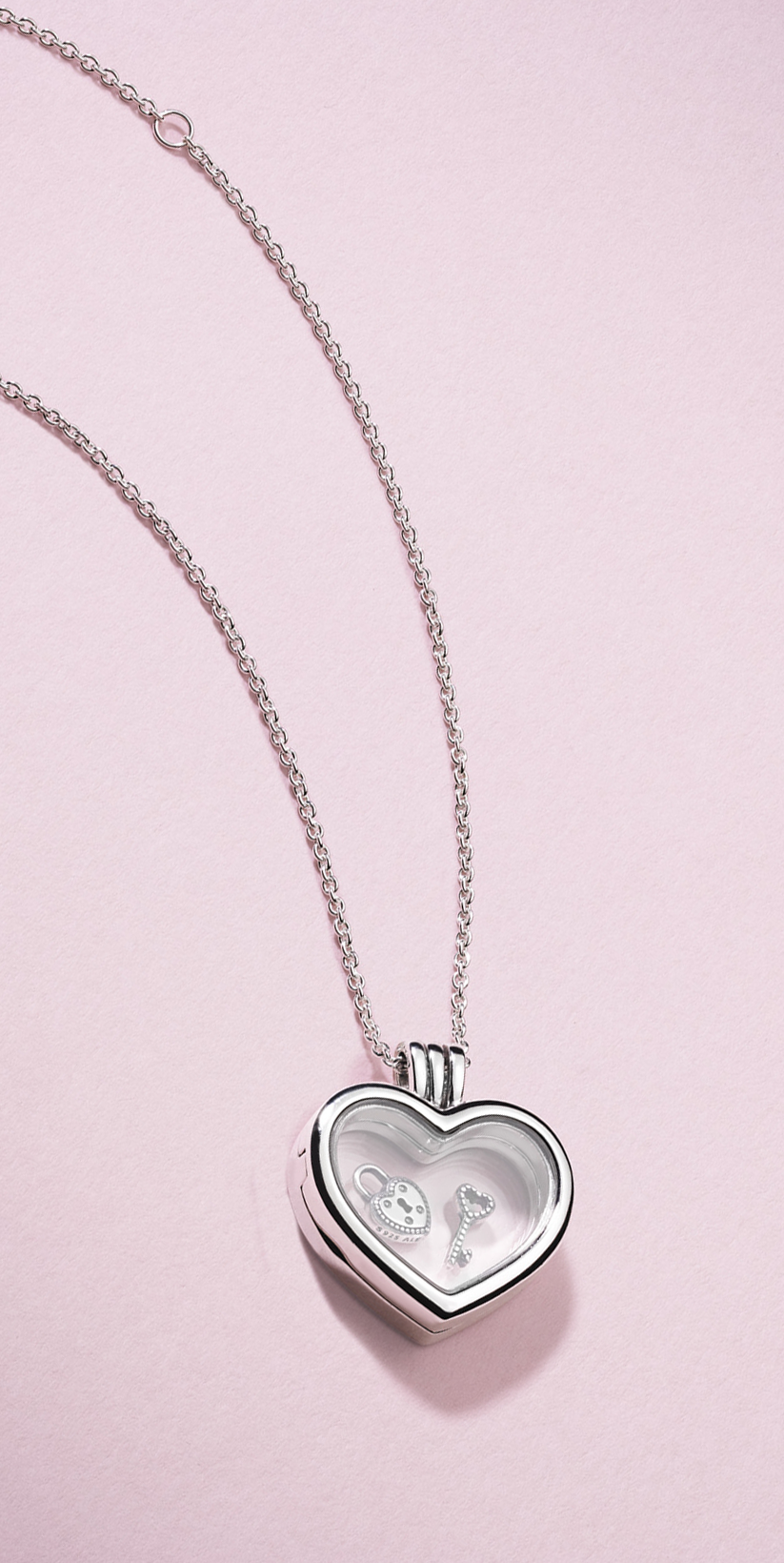 Personalise your love with the PANDORA sterling silver heart locket. Choose your personal petite favourites for your own unique love statement.