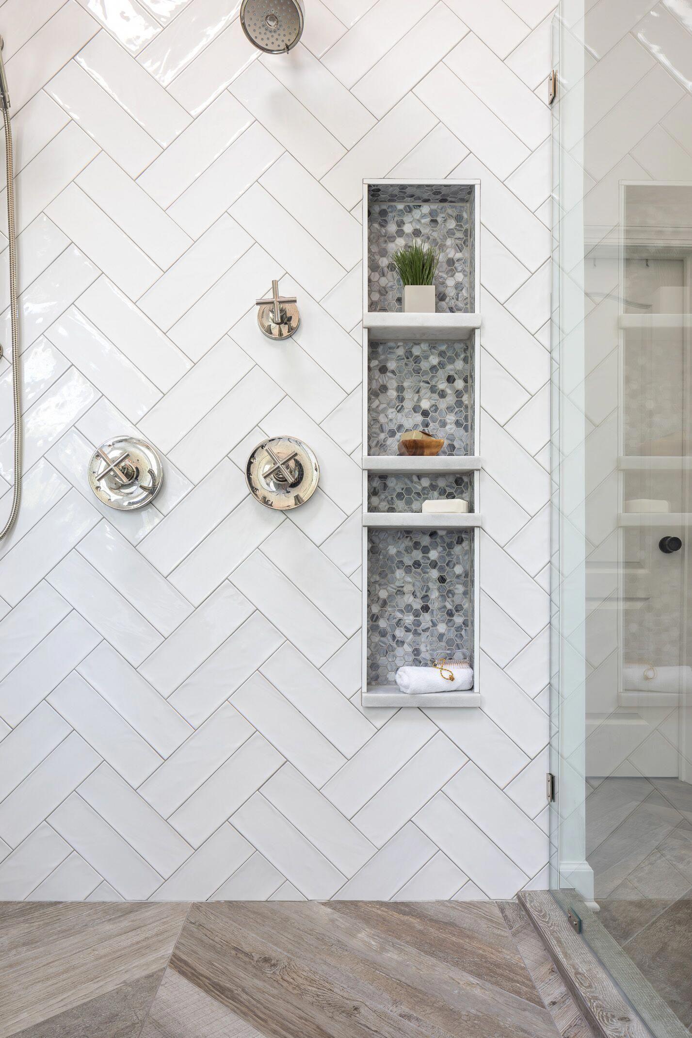 Modern Farmhouse Style Shower Design With White Double Herringbone Tile Frameless Glass Shower Surro Master Bathroom Shower Farmhouse Shower Bathrooms Remodel