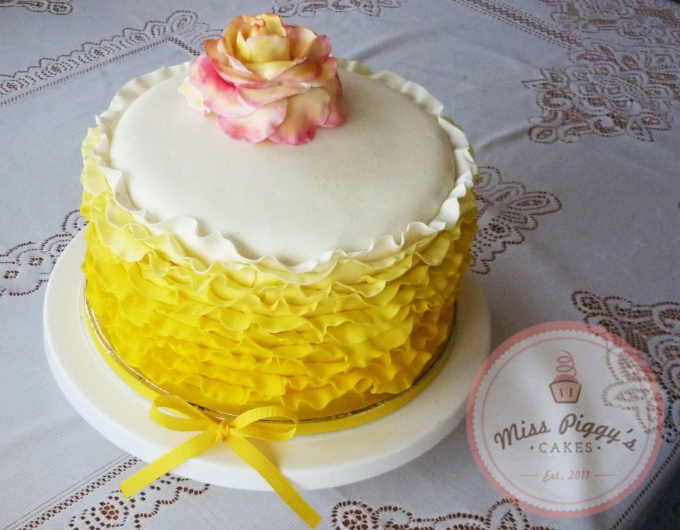 Sunshine Frills Yellow Ombre ruffle cake with fondant rose and