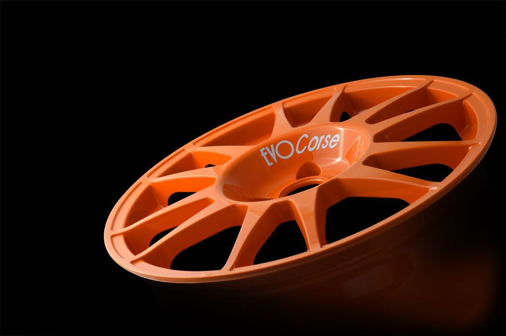 SanremoCorse is the successful range of wheels realized for being used on tarmac. - EVO Corse Wheels #evocorse #wheels #orange #alloywheels #rally #madeinitaly #beautifulwheel