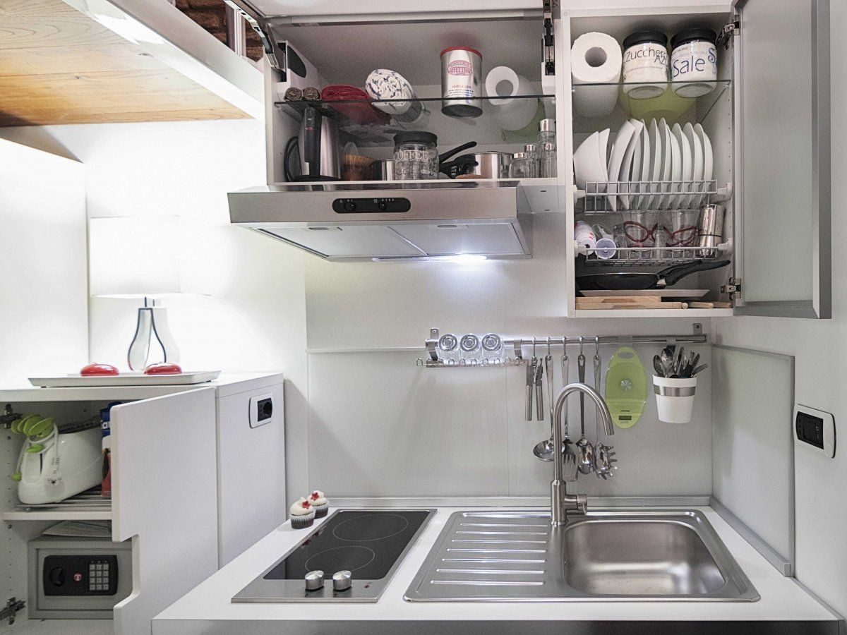 The Smallest House In Italy Is Architecturally Stunning Tiny House Kitchen Kitchen Design Small Tiny Kitchen
