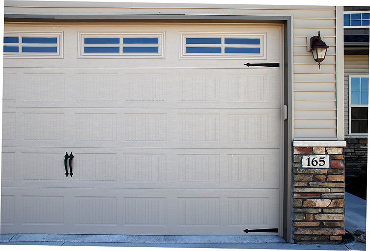 Traditional Steel Model 392 Desert Tan V 12 Stamped Panel Design Stockton 4 Lite Windows Garage Door Styles Residential Garage Doors Garage Doors