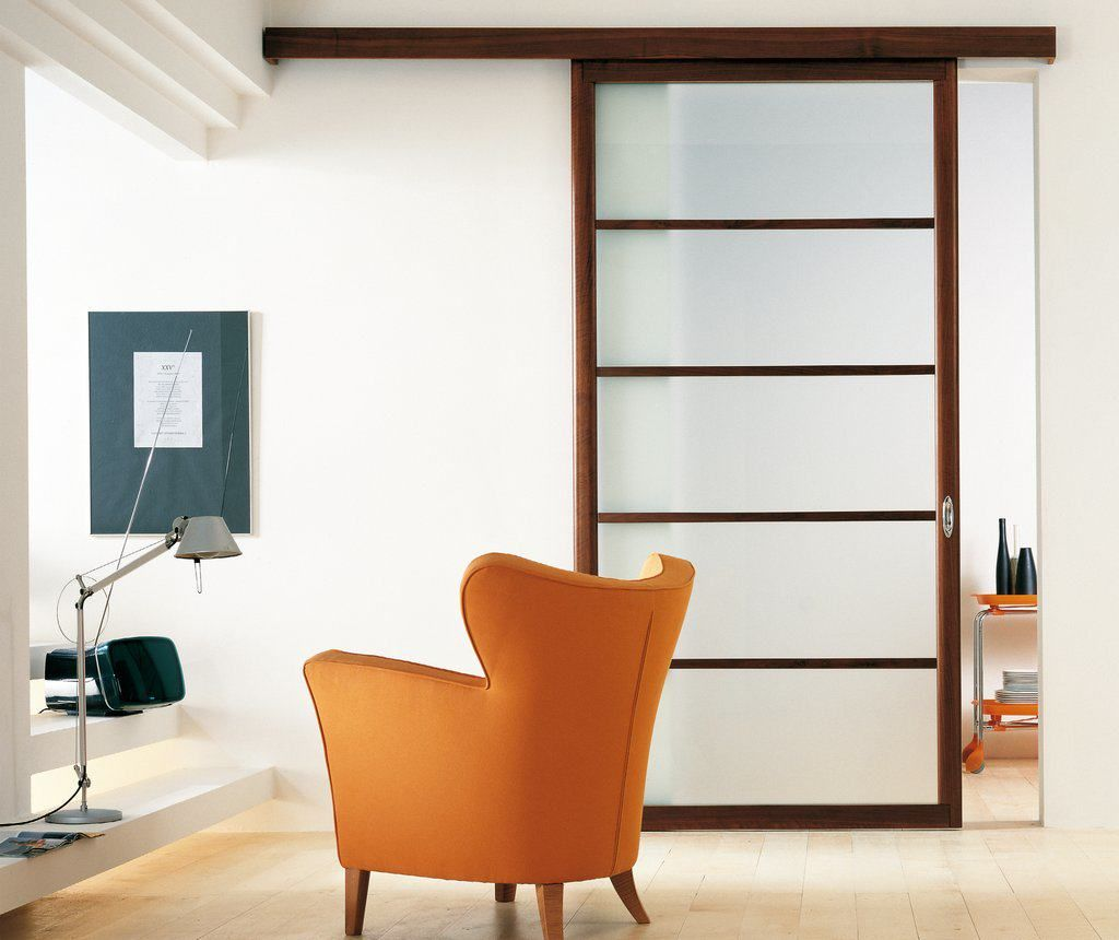 Exit Sliding Door Featuring Acid Etched Laminated Glass With