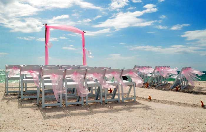 A blush of color across a warm azure sky ... a dream Florida beach wedding crafted by Suncoast Weddings
