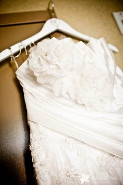 Flowers embellish on a wedding dress. A beautiful dress for a fall outdoor wedding. Photograph By Zev Fisher Photography. Wedding design and planning by Elegant Aura, elegantaura.com. Click to see more wedding photos!
