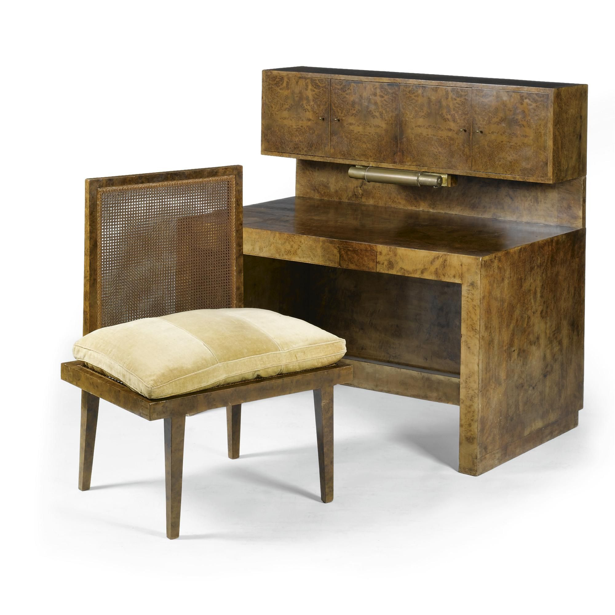 JOHANNES ITTEN (1888 - 1967) A DESK AND CHAIR burr walnut veneer, the rectanular desk with an inbuild drawer to front, the top with a cabinet enclosing pigeon holes and drawers, with reading light; together with a wide side chair with cushion desk: 75cm. long by 135cm. wide by 80cm. deep; cabinet: 35cm. high by 135cm. wide by 28cm. deep; 2ft 5½in., 4ft 5 1/8 in., 2ft 7½in.; 1ft 1¾in., 4ft 5 1/8 in., 11in. 1928 - 1930