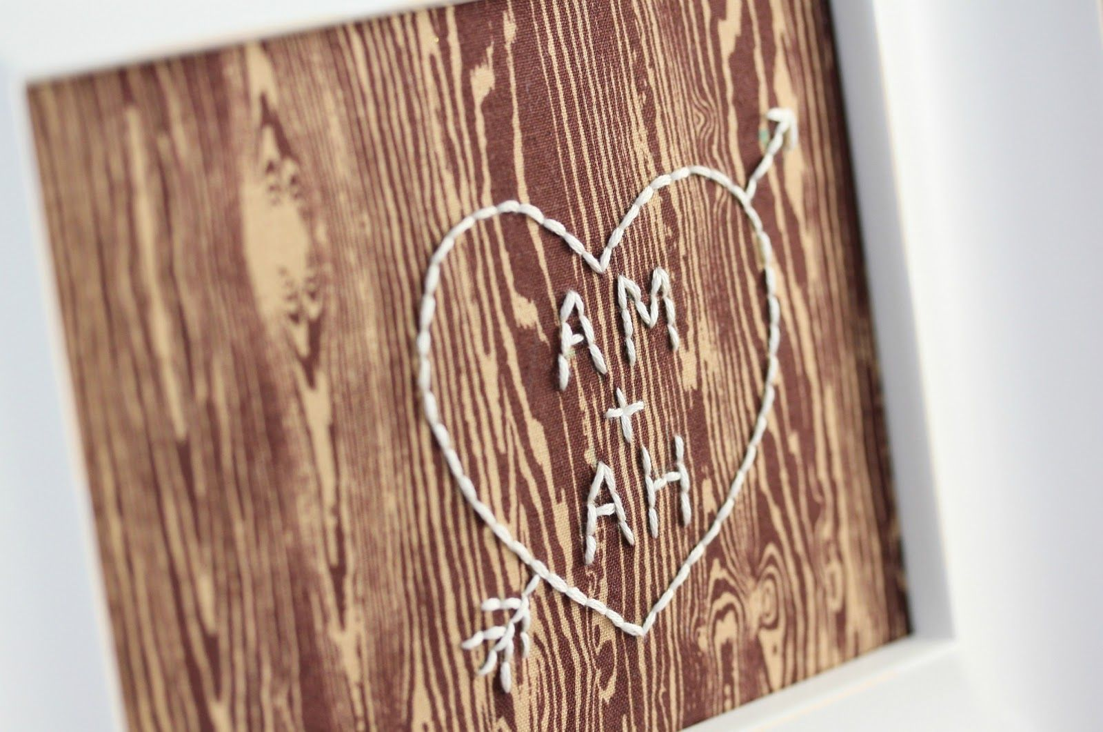 embroidery heart and initials on woodgrain fabric - cute idea! Maybe a pillow or a small throw blanket?
