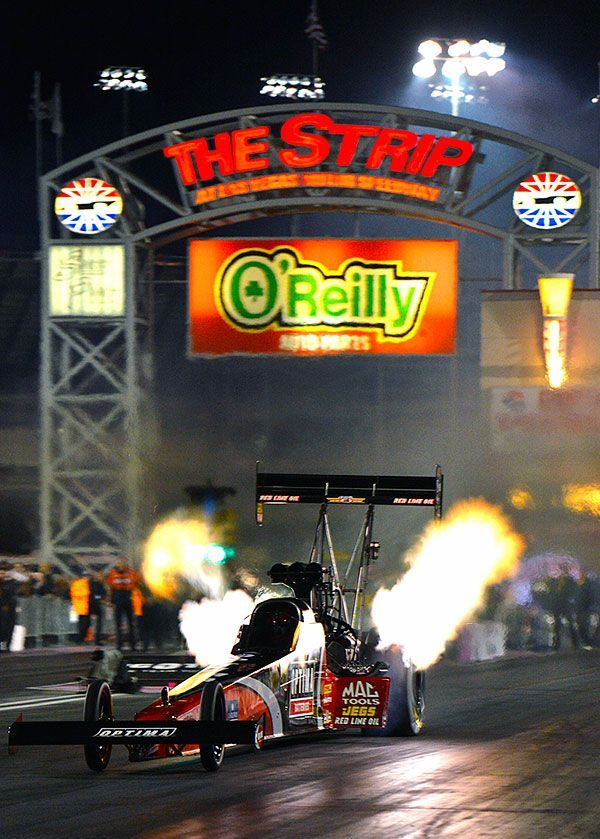 """""""Grubby"""" and the Optima Batteries Top Fuel dragster lighting up """"The Strip"""" in Vegas!"""