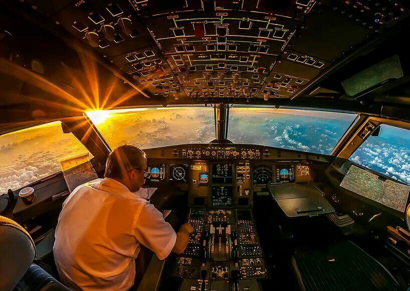 Sunrise in airplane cockpit.