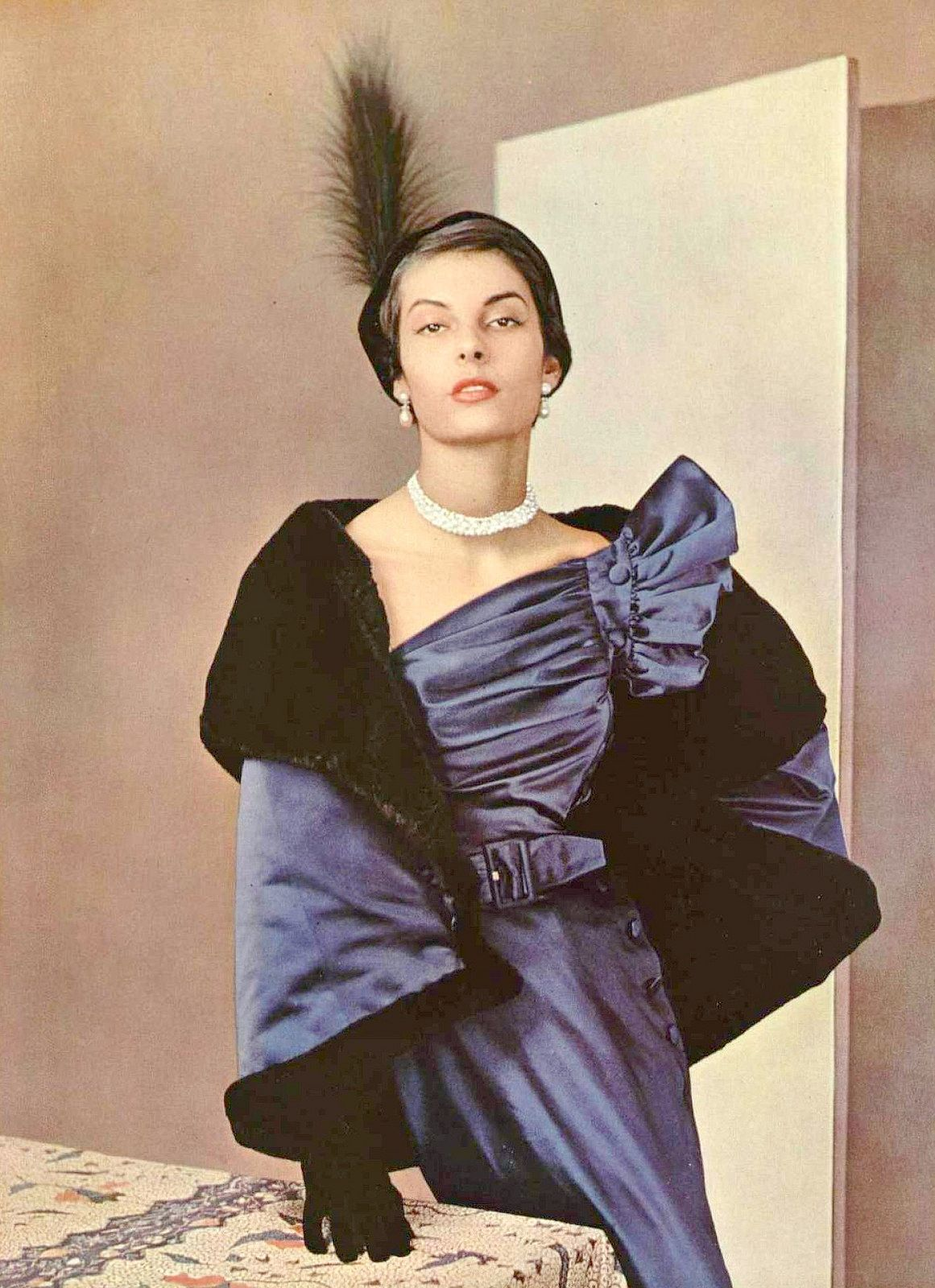 Model in satin dinner dress with matching fur lined cape by Robert Piguet, photo by Pottier, 1949