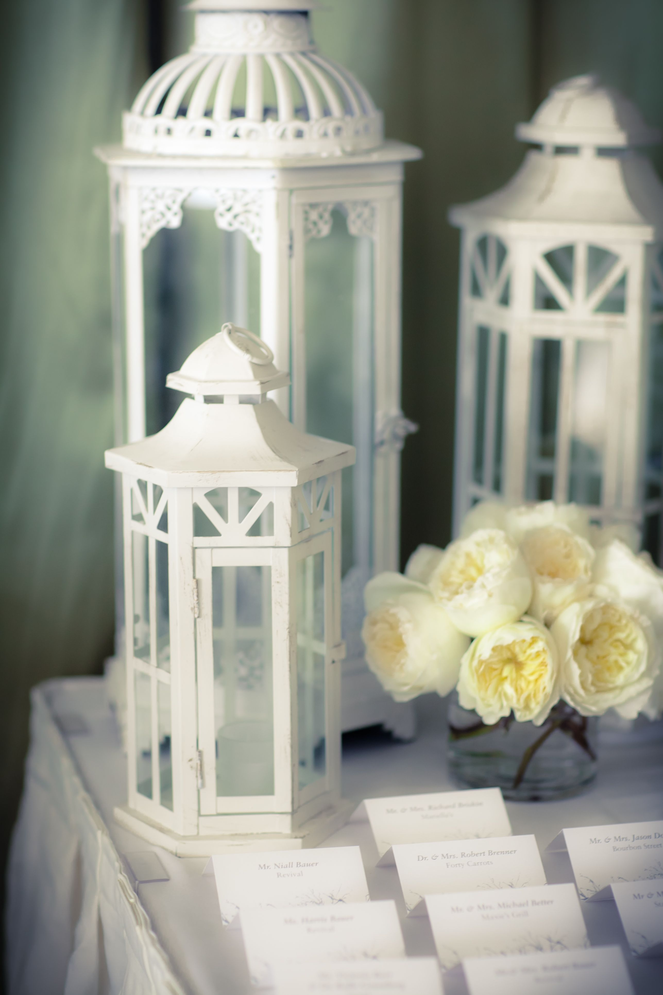 Wedding ideas with lanterns  Escort Card Table with white lanterns and peony arrangement designed