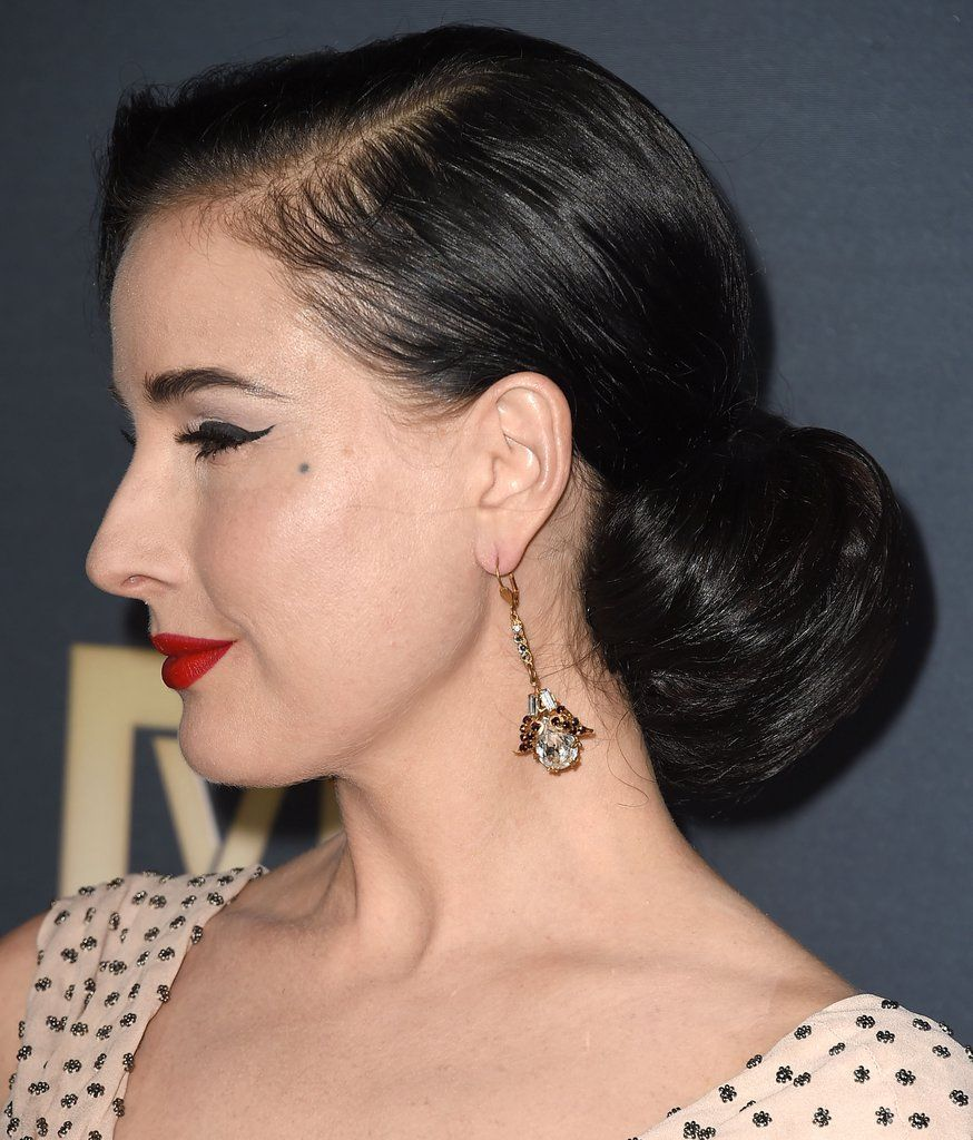 Dita Von Teese's Advice on How to Land on Your Oneofa