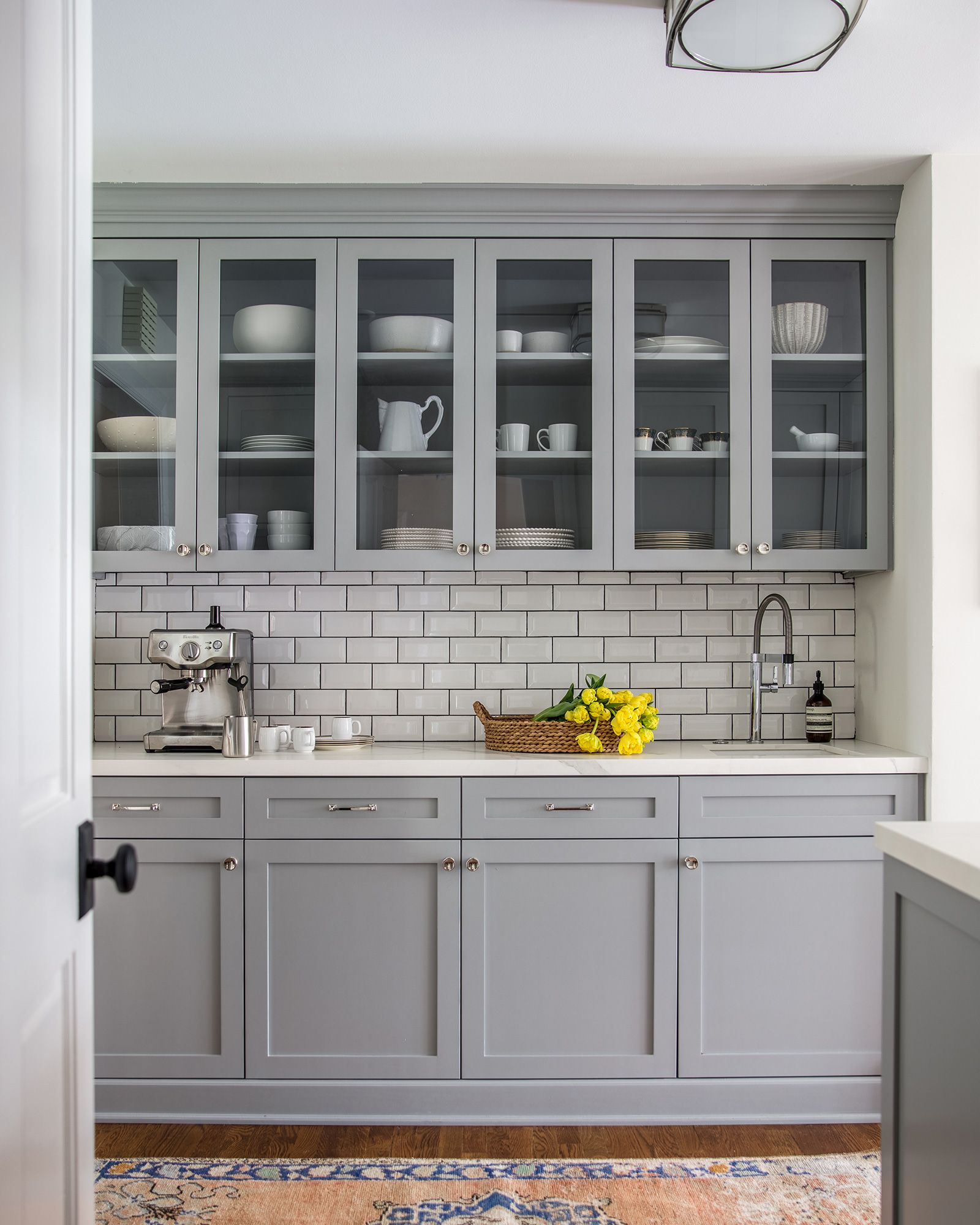 Blue Gray Cabinetry In The Kitchen With White Subway Tile And Dark Grout Antique Runner With Dark Grey Kitchen Cabinets Grey Kitchen Cabinets Kitchen Design
