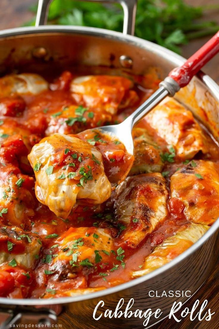 Classic Cabbage Rolls Recipe  with tender cabbage leaves stuffed with rice seasoned ground beef and caramelized onions simmered in a rich tomato sauce thats a little swee...