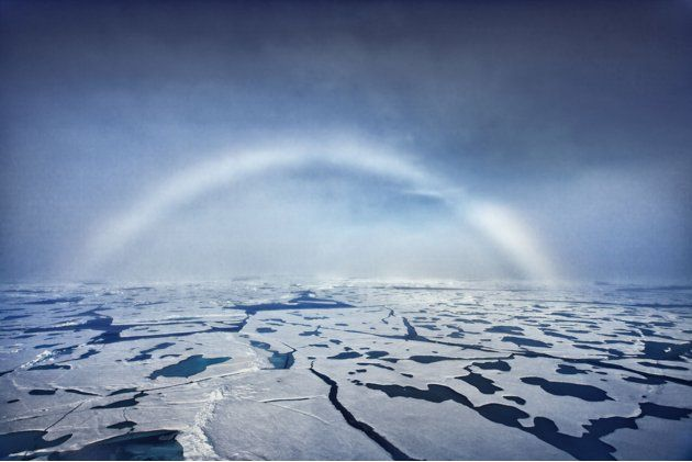 White rainbow formed in fog at the North Pole
