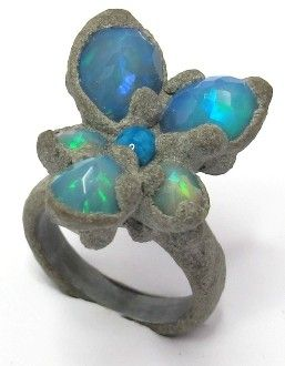 Viola Opal Ring, made of  cement, silver, and wood and of course OPALS!!! Such a cool piece! Wow! favoloso!!!!!!!!