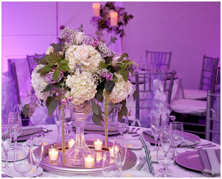 White hydrangea and purple rose mini chandelier style centerpieces white hydrangea and purple rose mini chandelier style centerpieces with votive candles purple uplighting aloadofball Choice Image