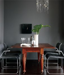 amazing wall color, and chandelier, and drop leaf table. Love the low hanging art too.