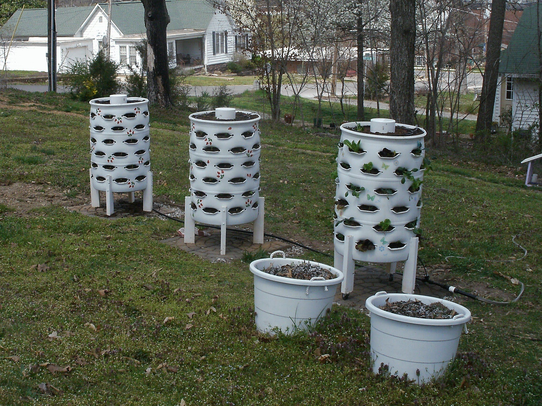 DIY container garden with composting tower in the middle space